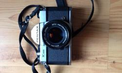 Pentax K1000 with a 50mm 1:2 lens for sale. Camera is