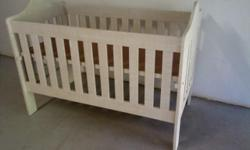 Cot has 2 levels. Its stone colour and has been