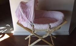 Beautiful Pink wicker moses basket with wooden stand.