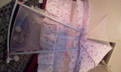 Pink Steel frame rocking crib for sale Wheels for easy
