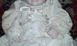 Porcelain Doll Made in 1967.  Needs a good clean.  R500