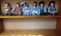 6 dolls with porcelain faces.