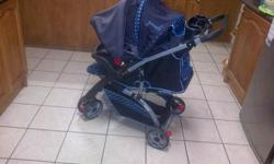 Pram, reversible handle and car seat . Good condition.