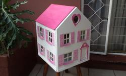 Pretty pink & white doll house. Bigger than a miniature