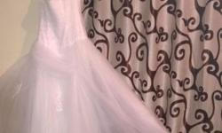 Hi, This a a size 36 Brand new Wedding dress for sale.