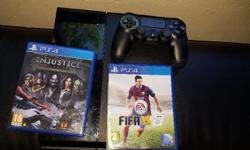500 gig ps4 with two games fifa 15 and injustice.1
