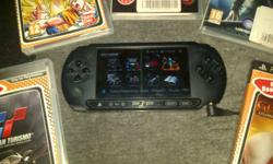R900 psp + 5 games , like new still has box n charger.