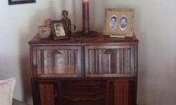 This is an antique Radiogram in excellent condition.