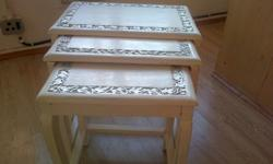 Restored nest of solid wood tables with silver leaf