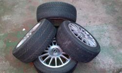 4 imola 15inch rims containing 3 tyres 195/50-15