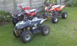 Two quad bikes for sale. One is a Sam 250cc quad bike.