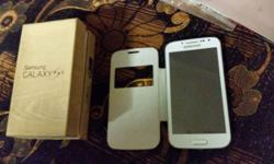Samsung s4 white bearly used exelent condition comes