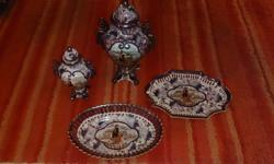 I have a set of Hand Painted porcelain Chinese Styled