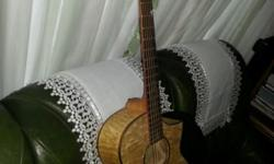 semi acoustic guitar, cord and guitar bag