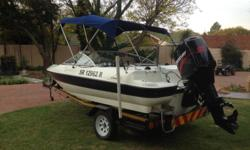 Sensation boat with 125 Mercury motor for sale, in mint