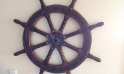 I'm looking for an old ship's spoked wheel in brass and