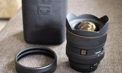 Sigma 12-24mm f/4.5-5.6 DG HSM lens for Canon. Minor