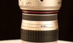Sigma 28-300mm zoom lens. Good condition. No auto