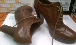 AS NEW! Leather. Mid brown in colour. Size 6. Worn