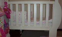 White Sleigh Cot with safety mattress. Cot has multiple