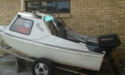 Small 2 man cabin boat with 25hp Suzuki motor with