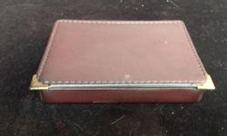 Small leather clad box. Old leather. You decide for