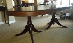 6 seater dining room table which is extendable to an 8