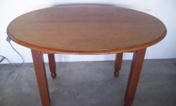 A solid teak oval table for sale. Good condition.
