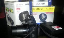 Compact Sony H-20 Digital Camera with adaptor ring and