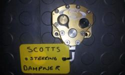 SCOTTS STEERING DAMPNER. VERY GOOD CONDITION. AS PER