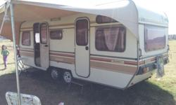 Double axles caravan with full tent and poles