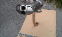 Original factory exhaust from a 2009 BMW R1200S boxer