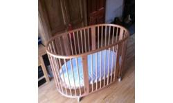 For sale a Stokke Cot with Mini Cot conversion kit, in