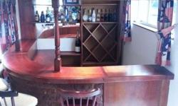 Stunning bar area for sale with 5 wooden bar stools