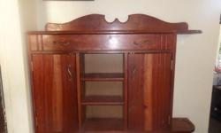 This amazing hand made, solid wood Rhodesian Teak hall