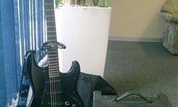 Gloss black SX electric guitar in beautiful condition