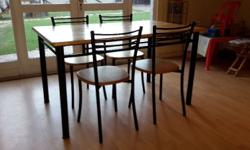 Table & 4 Chairs for sale. Wooden top and Rod Iron