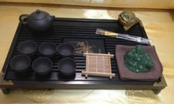 Beautiful handmade black ceramic tea set with special