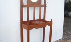 Semi antique teak hallstand with bevelled mirror in