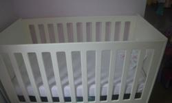 Lovely white Treehouse cot, which has two different