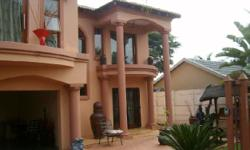 Tuscan double storey house with 4 bedrooms, 3