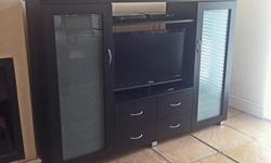 Well maintained TV cabinet with ample storage space and