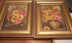 I have two matching oil flower pictures . Both for