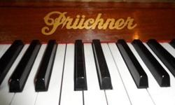 Prüghner upright piano for sale. Good over all