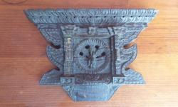 Very old wooden wall plaque. Made of many slices of