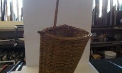 Vintage cane shopping baskets on wheels. Still in great