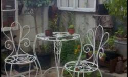 Very cute handmade solid steel table and 2 chairs