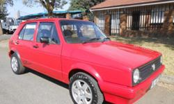 VW Golf Chico..Red....Manual...1.3 Petrol engine...