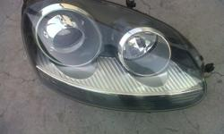 Vw golf 5 gti right front headlight good condition