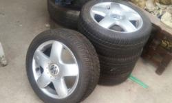 IM SELLING A SET OF VW POLO MAG WHEELS. THE DUNLOP